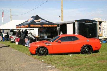 Lightner's Challenger featured in Glow Shift gauges booth.